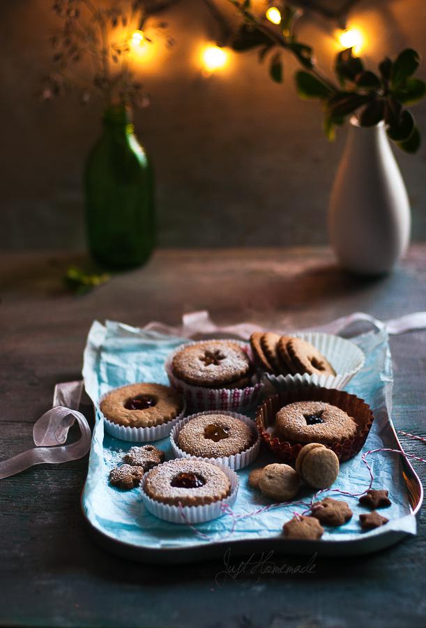 linzer cookies in tray vase bokeh lights